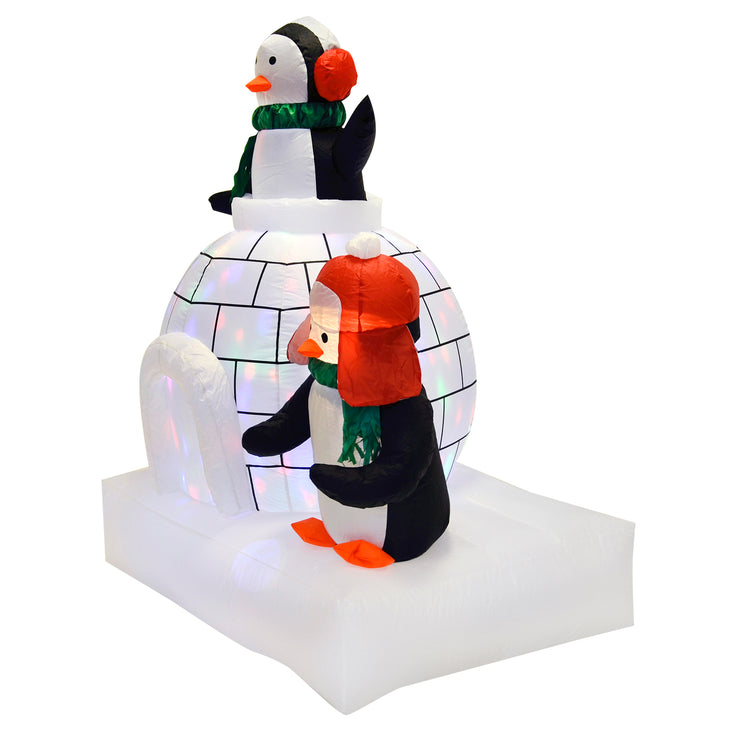 side view of 5ft christmas inflatable with penguin and igloo