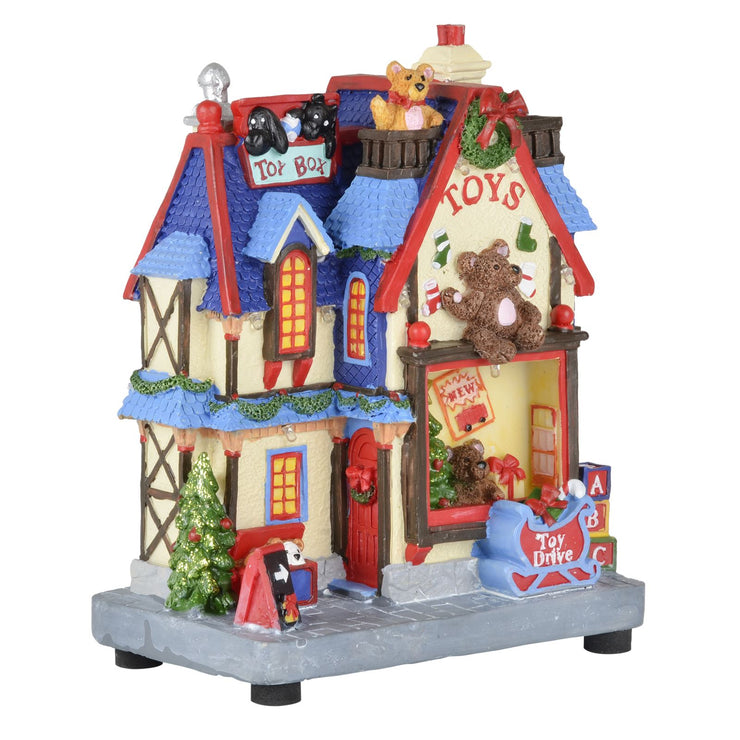 side view of toy shop christmas scene ornament