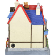 back view of toy shop christmas scene ornament with power supply
