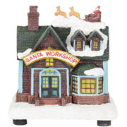 front view of santa workshop christmas scene ornament