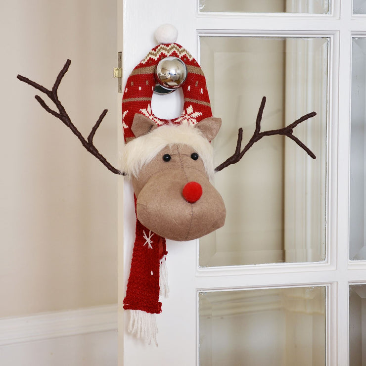 reindeer christmas door hanger in a room setting