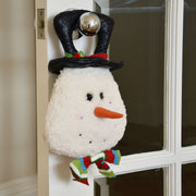 snowman door hanger hanging from door in living room setting