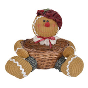 front view of gingerbread lady decoration featuring snow flocked hat with wicker storage basket