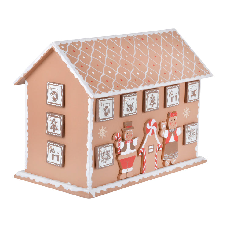 side view of gingerbread house advent calendar featuring 3 little drawers on the side