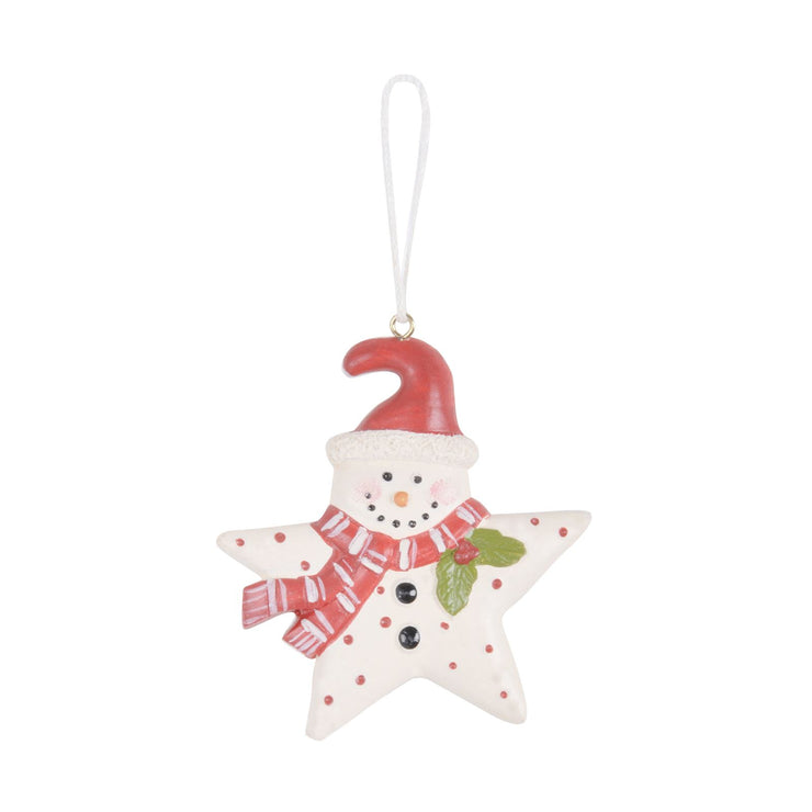 white star shaped tree decoration with red santa hat and scarf with polka dot print and holly leaves and berries