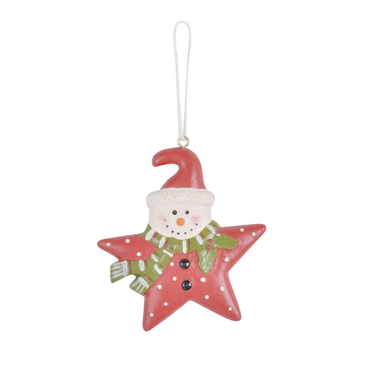 red star shaped tree decoration with red santa hat and green scarf with white polka dot print and holly leaves and berries