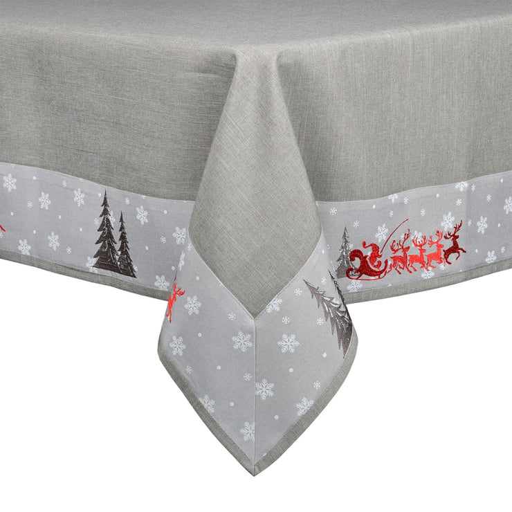 grey fabric tablecloth with embroidered santa and reindeer christmas scene