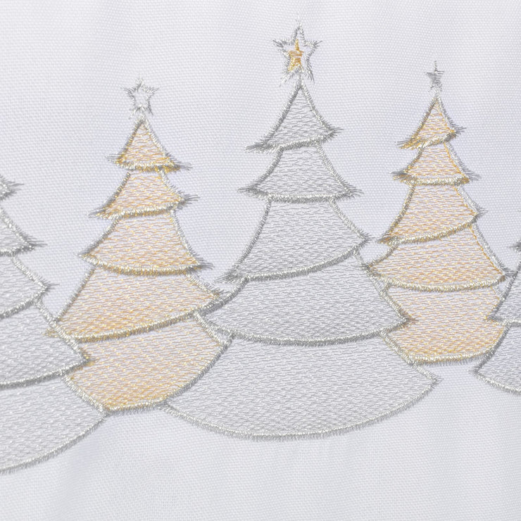 detail shot of silver and gold embroidered christmas trees