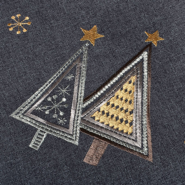 close up of embroidered contemporary christmas tree design in gold silver and brown colours