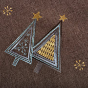 close up detail of embroidered christmas trees