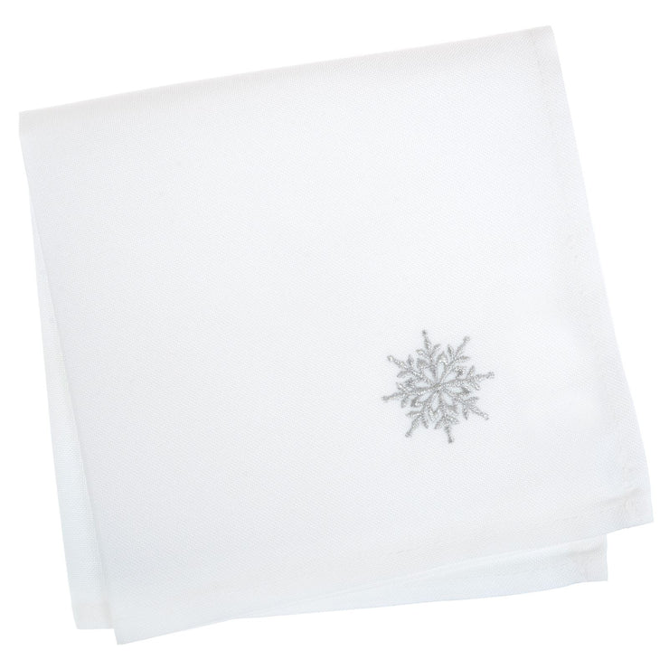 set of 4 white napkins with embroidered silver snowflake in the corner