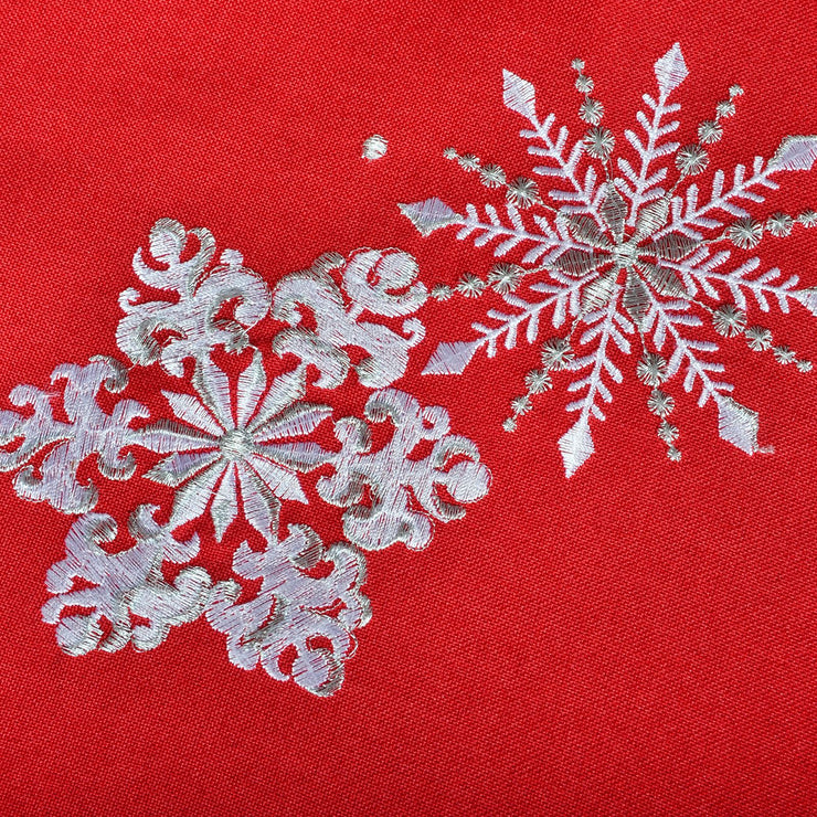 detail shot of silver and white embroidered snowflake design