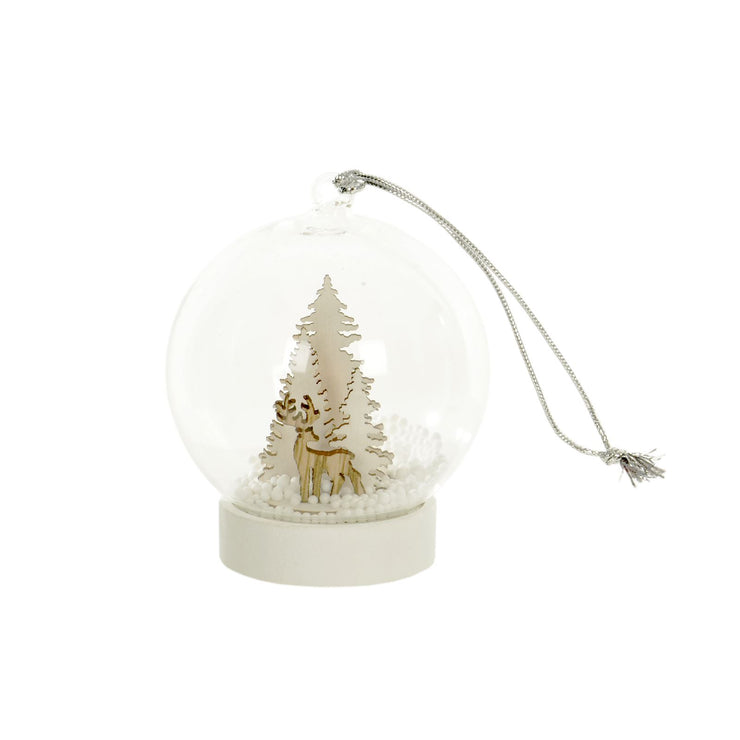 glass globe tree decoration featuring wooden reindeer and white tree design with foam snow balls