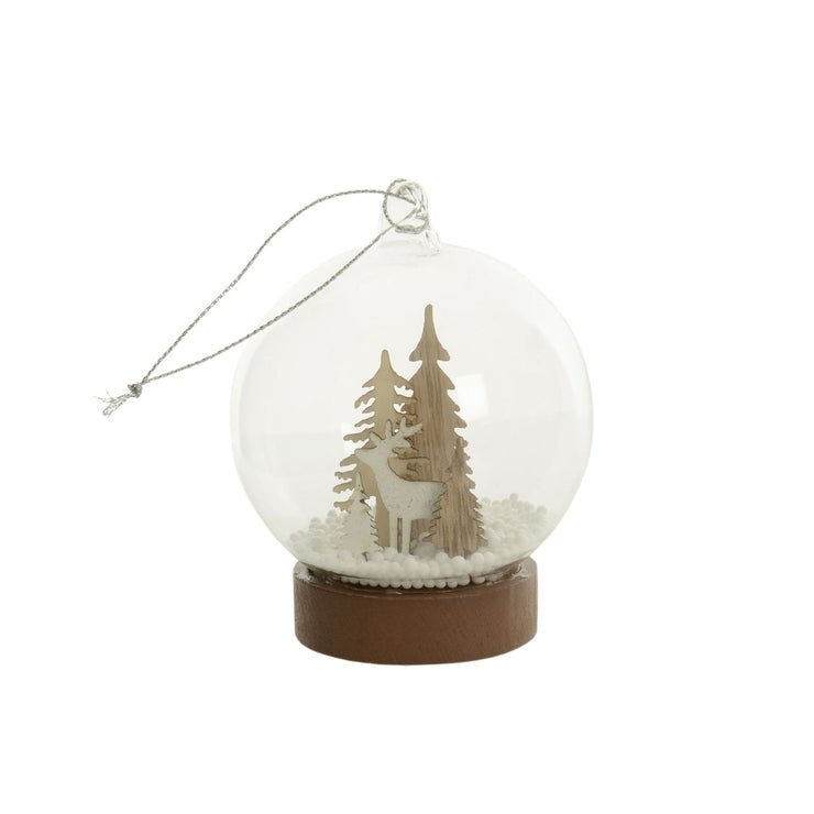 glass globe tree decoration featuring white and brown wooden tree and reindeer decoration with faux snow