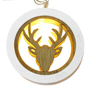 detail shot of individual light featuring reindeer head inside wooden circle with one warm white LED