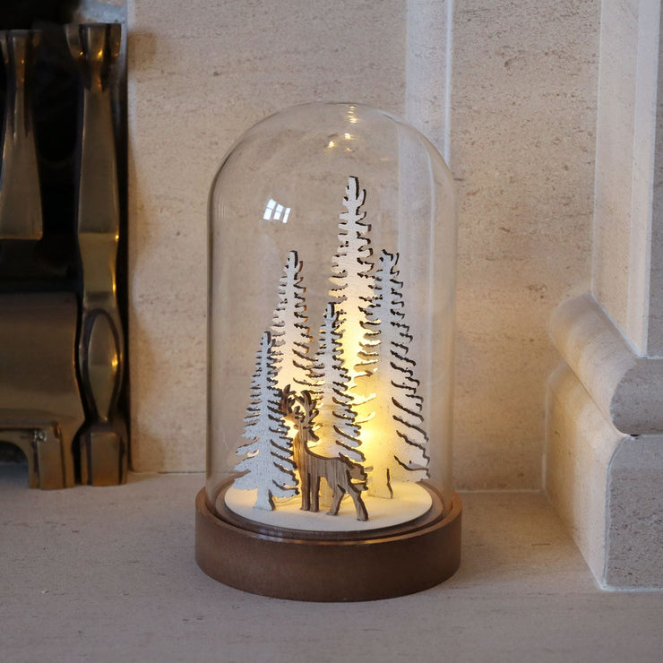christmas dome reindeer ornament with warm white led lights on fireplace in lounge