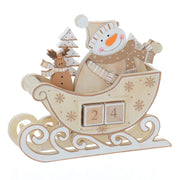front view of wooden snowman countdown calendar with christmas tree and mini reindeer toy