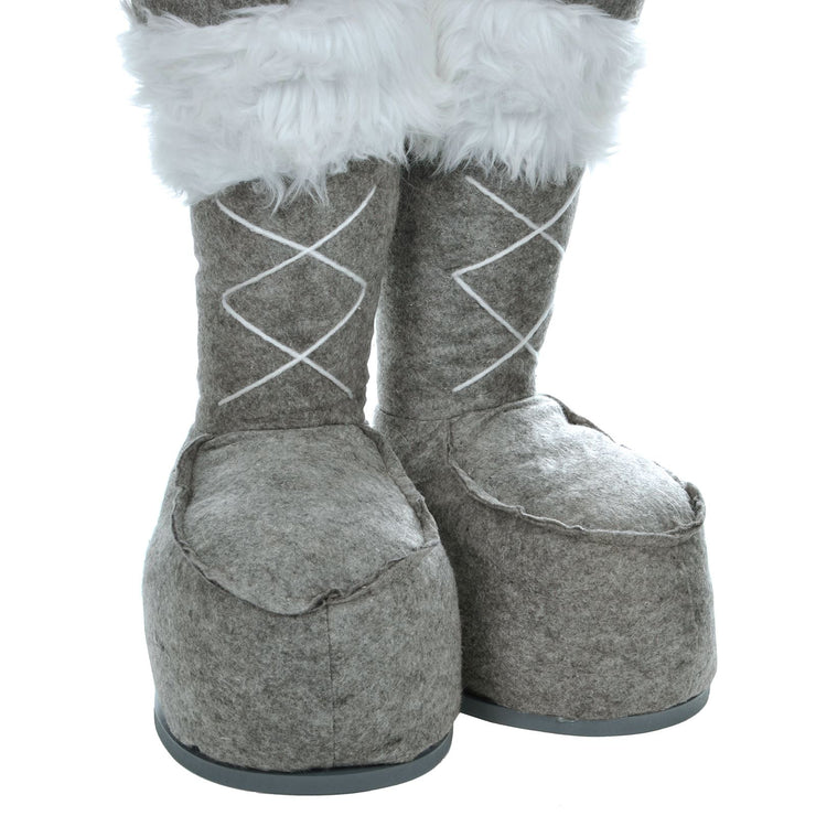 close up detail of winter boots with white faux fur trim