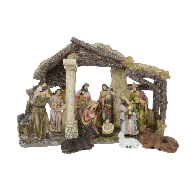 front view of large nativity scene featuring donkey, sheep and cow and traditional christmas characters