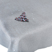 close up of christmas tree detail embroidered on grey tablecover