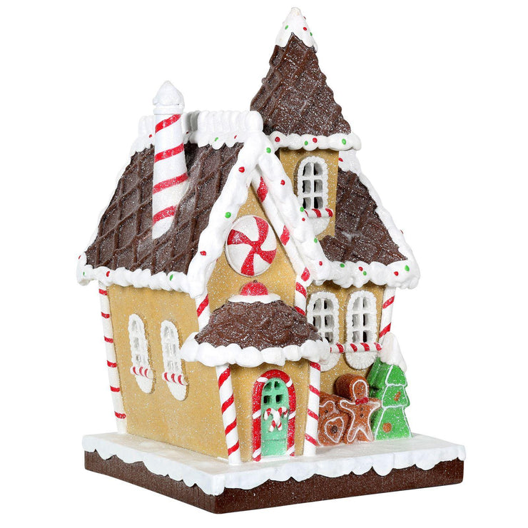 glittery gingerbread house ornament with candy cane piping