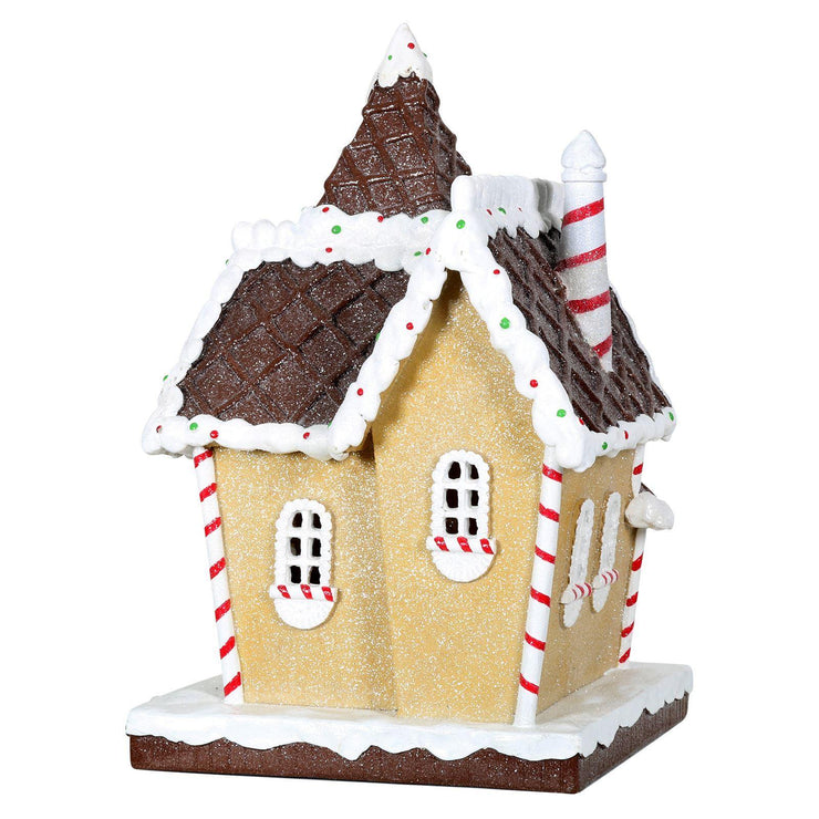 back view of gingerbread house ornament with window pane detailing and candy cane chimney
