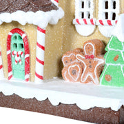 close up detail with ginger bread man, christmas tree and door with candy cane knocker