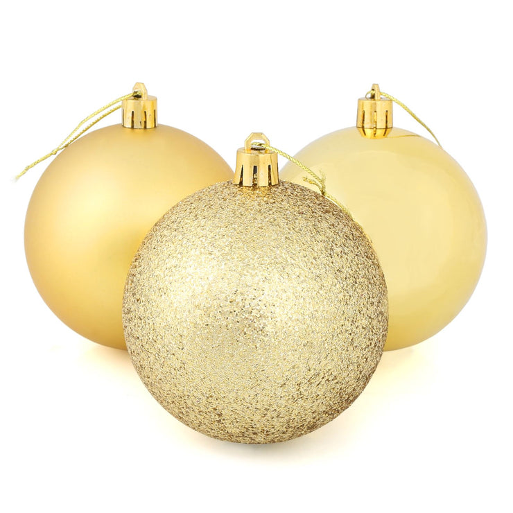 gold christmas tree baubles with glitter, shiny and matte designs