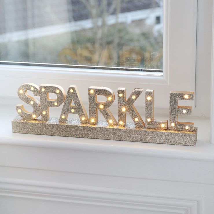 light up 'SPARKLE' christmas window sign featuring gold glitter finish with warm white led lights