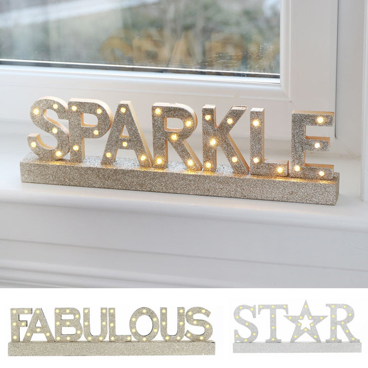 light up glitter covered christmas wood window sign available in 3 designs