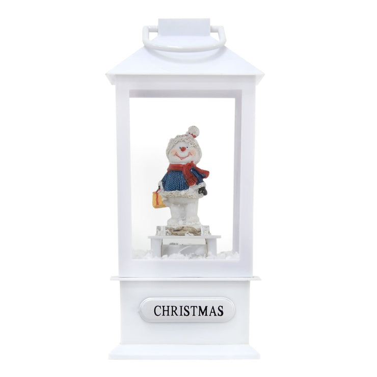 white musical lantern with snowman holding gift and christmas plaque