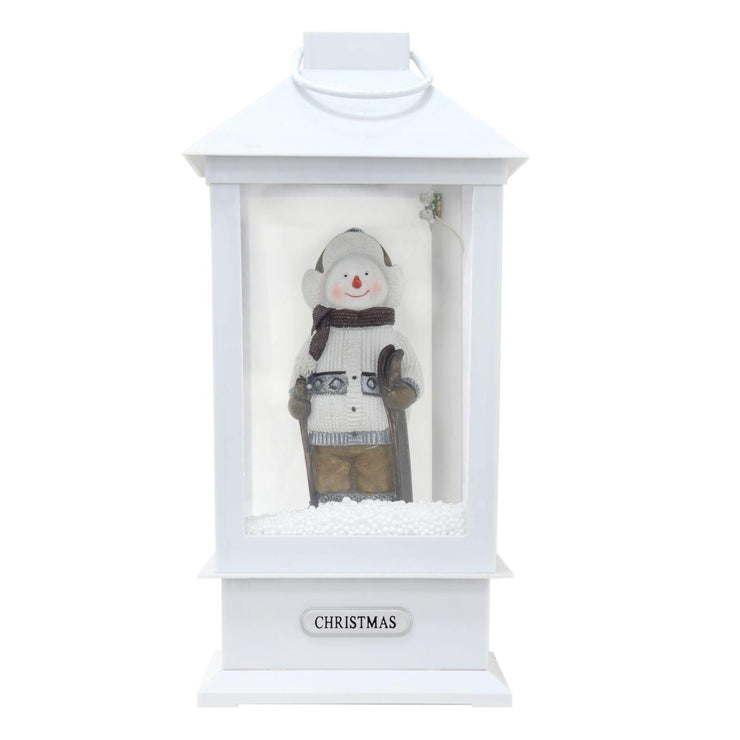33cm high white lantern with snowman figure light up and snowing effect shown unlit