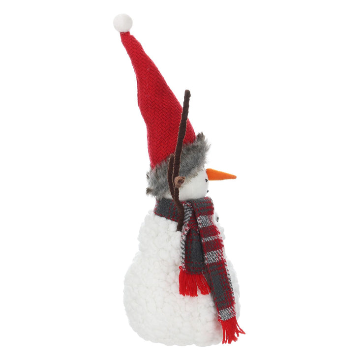 side view of snowman with hat and scarf accessories