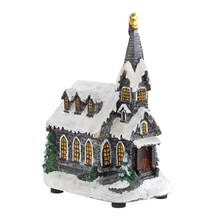 front view of christmas church snow scene with glitter