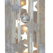 close up of wooden pillar decoration with silver christmas bauble and snow details