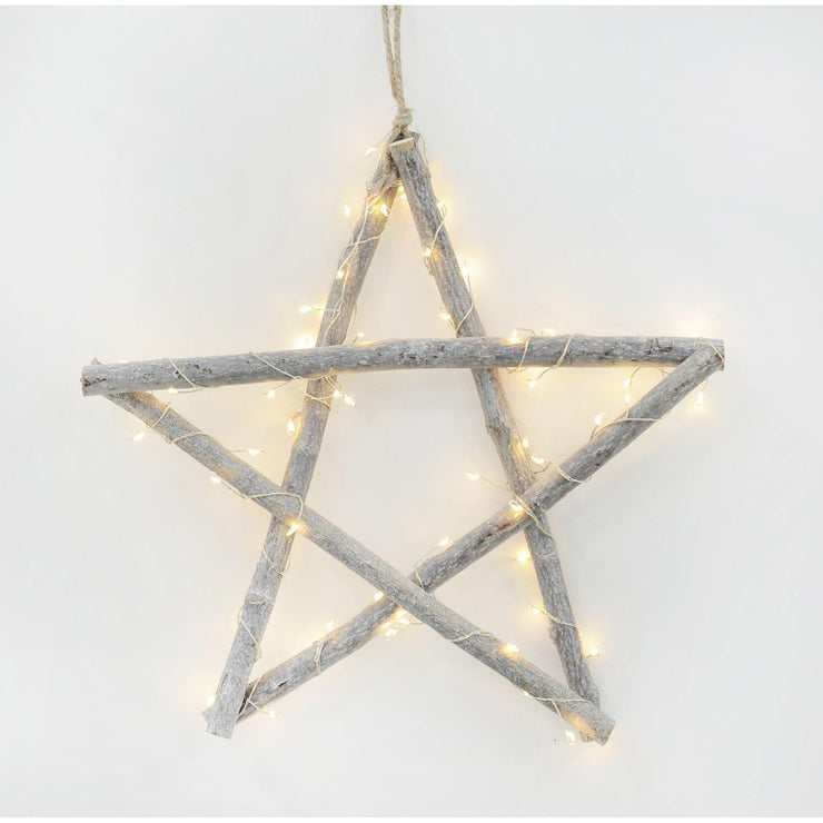 light up twig star decoration hanging on the wall with jute