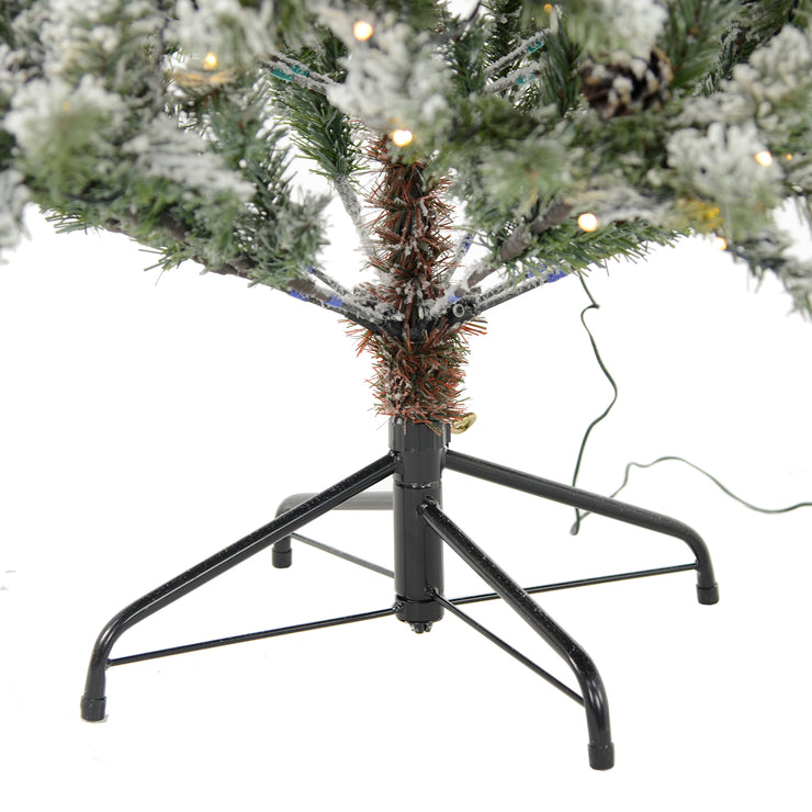 foldable christmas tree stand with christmas tree inserted and secured