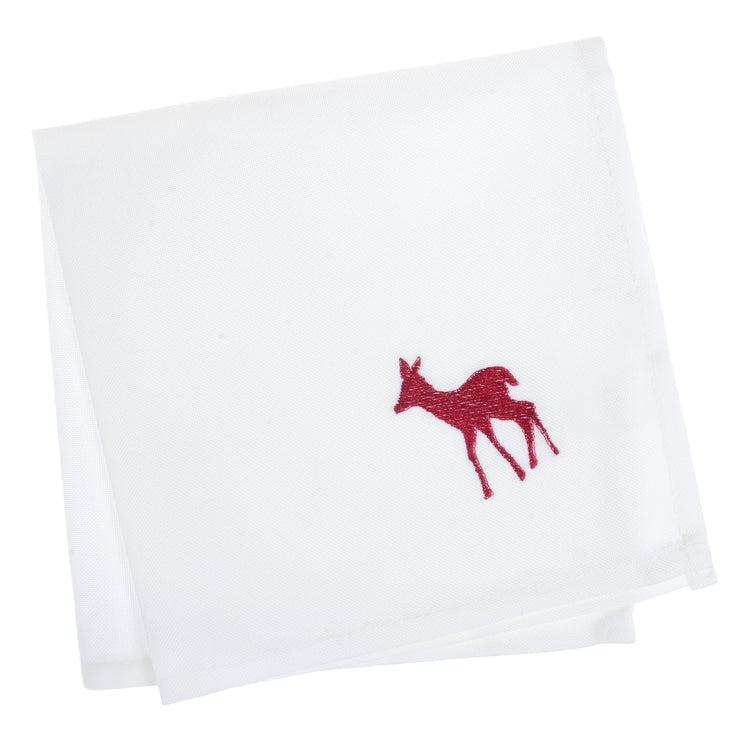 set of 4 white napkins with red emboirdered reindeer in the corner