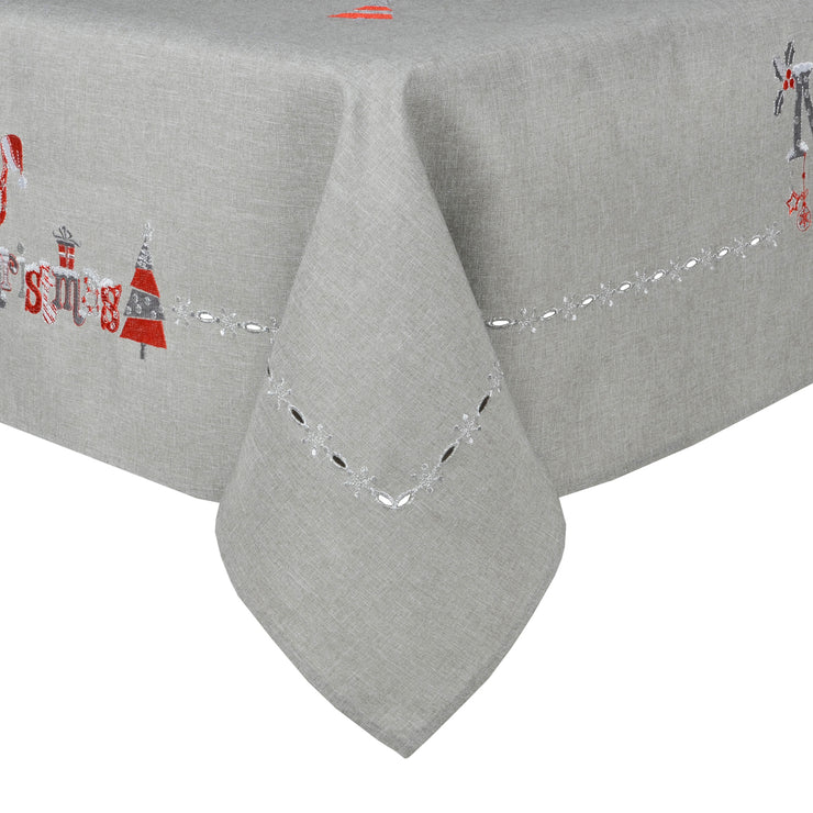 grey table cloth with cut out trim pattern and merry christmas embroidered design
