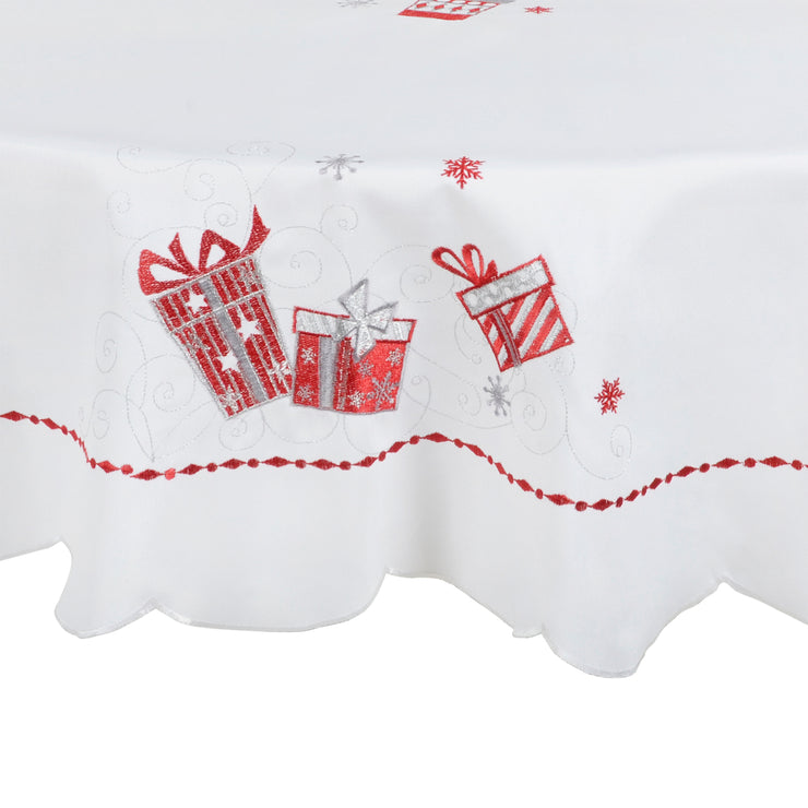 close up of red and silver embroidered gift detail with swirls and snowflakes
