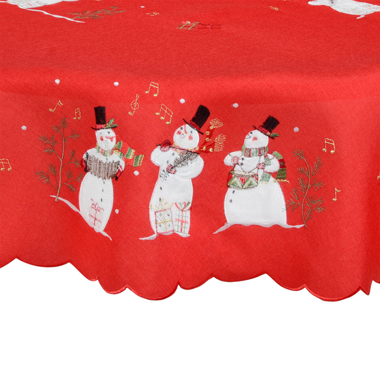 detail of three embroidered singing snowmen with musical notes and instruments