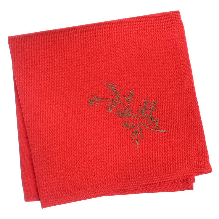 set of four red napkins with embroidered tree in the corner