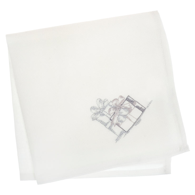 set of 4 white napkins featuring grey and silver embroidered christmas gifts in the corner