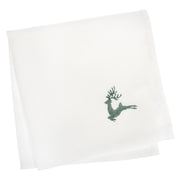 set of four white christmas napkins with green embroidered reindeer in the corner