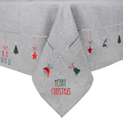 close up of embroidered details featuring santa heat, green christmas bell, red star and christmas tree designs