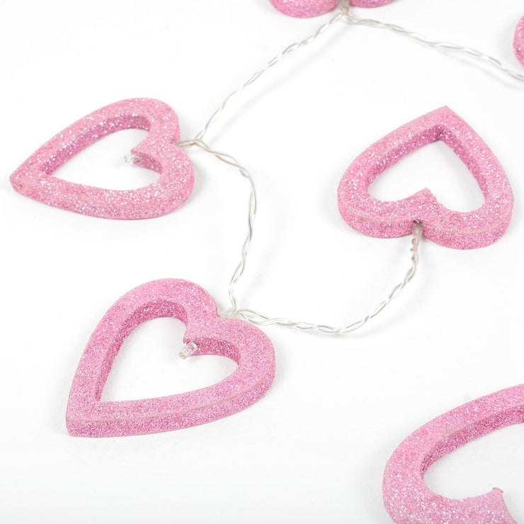 close up of glitter heart string lights