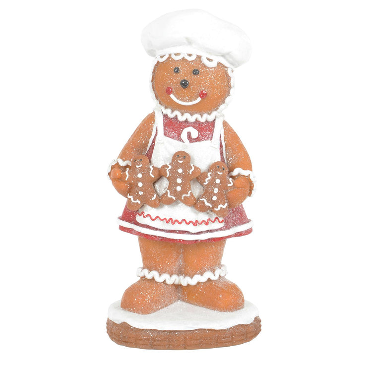 front view of 20cm gingerbread lady ornament featuring 3 little gingerbread cookies with a bakers hat and apron and finished with glitter