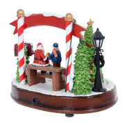 back view of christmas scene with rotating glitter christmas tree