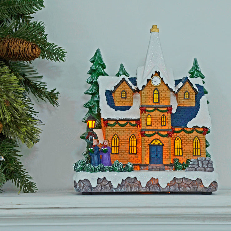 light up christmas church ornament on fire place ledge