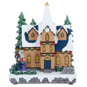 front view of christmas church ornament with two kids carol signing, christmas street lamp and snow covered christmas trees